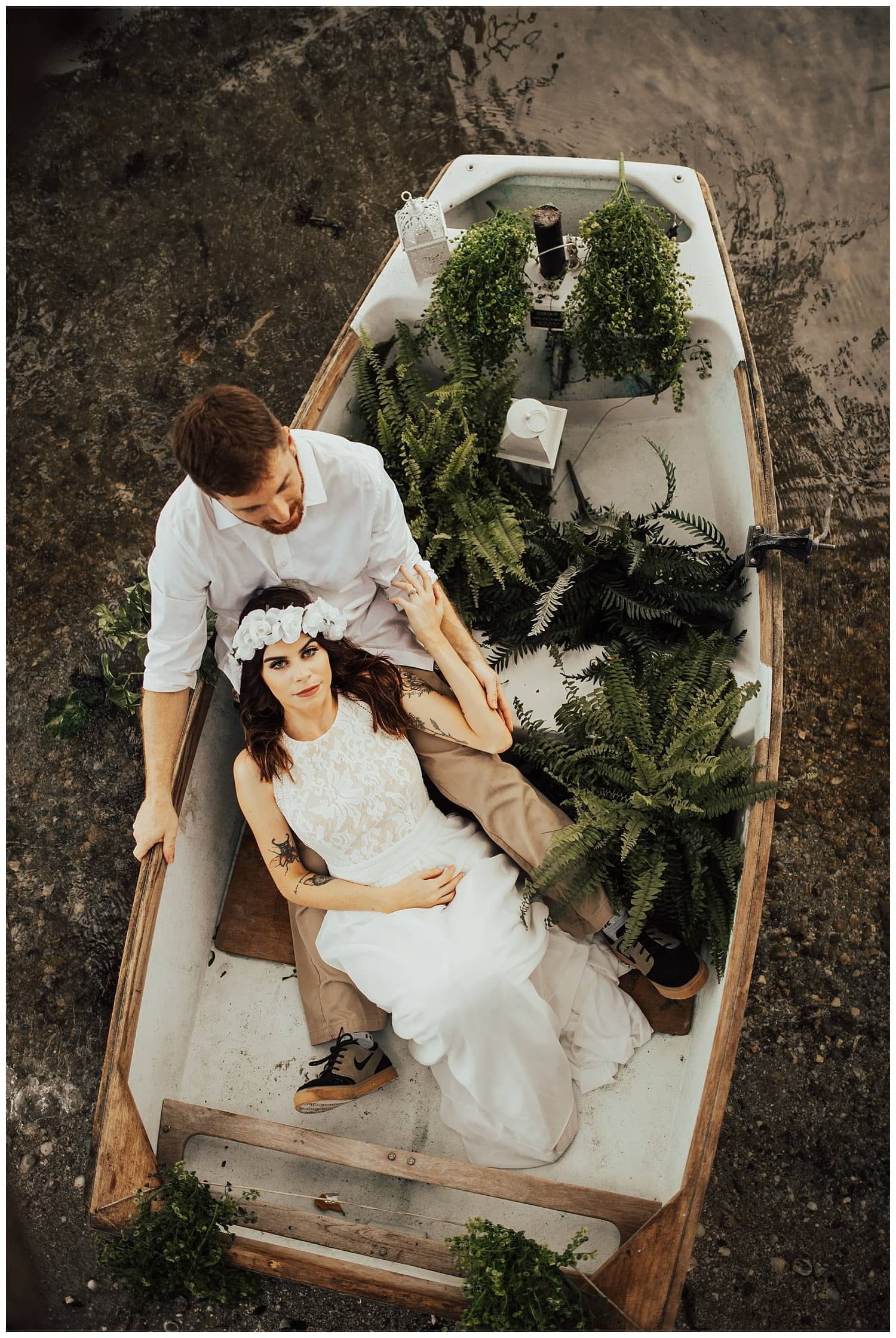 bride and groom in boat