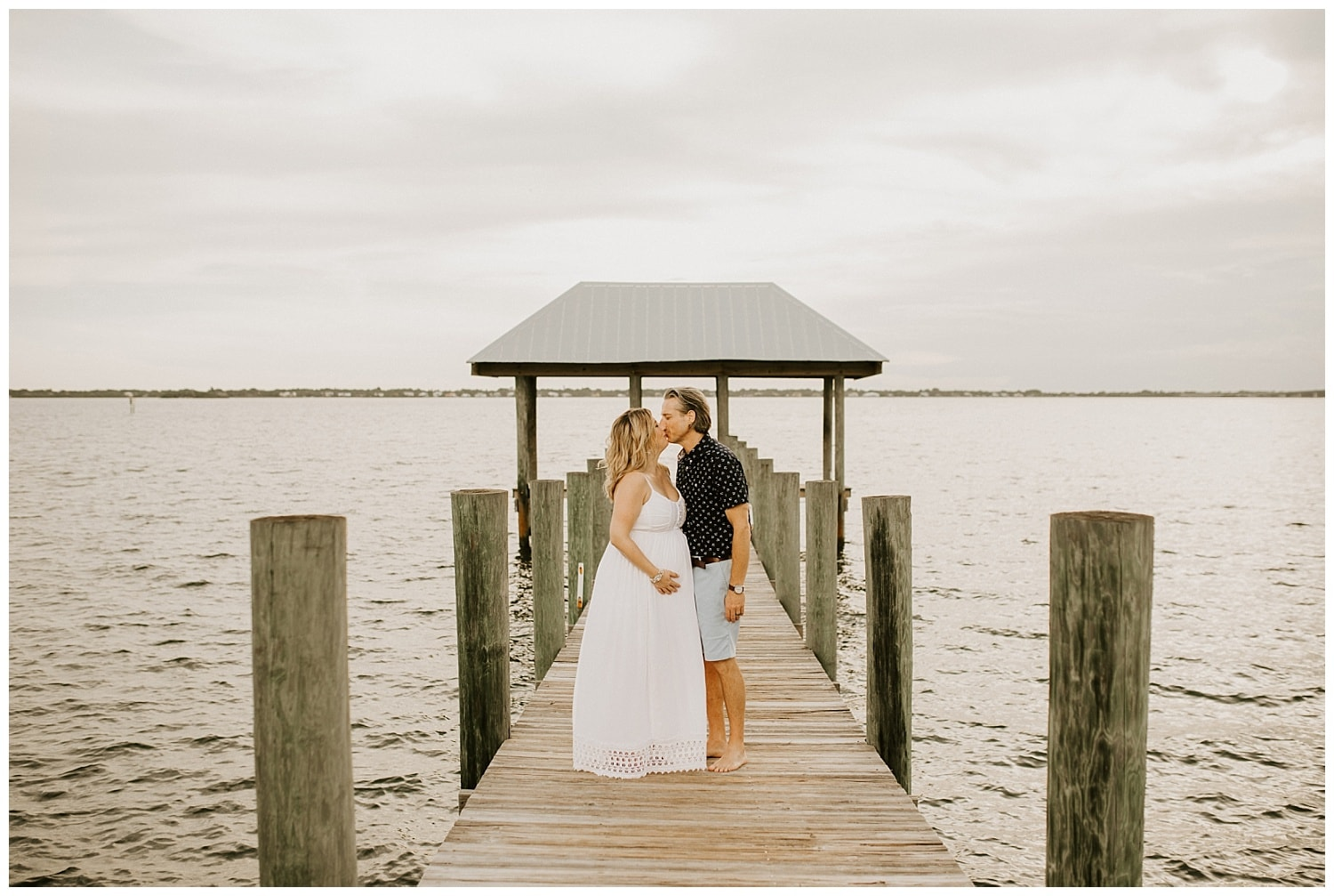 couple kissing on dock at house of refuge