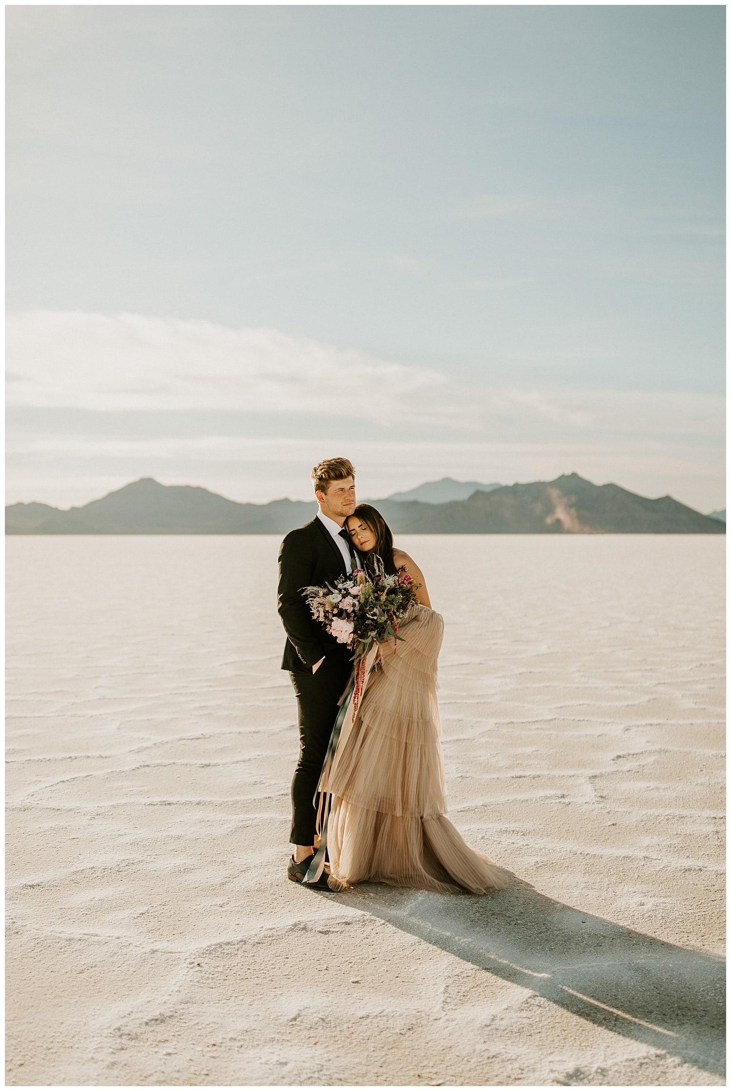 blush wedding dress, bonneville salt flats elopement, salt flats photography, utah wedding photographers