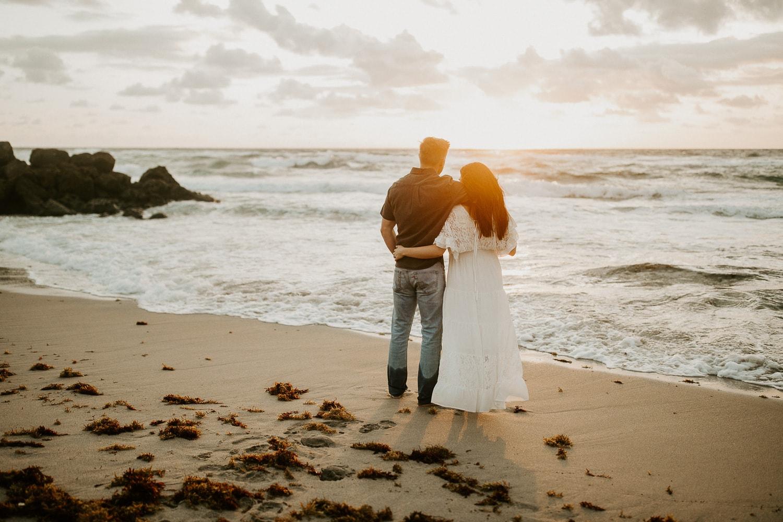 Bride and groom watching the sunrise on the beach in Deerfield Beach. Beach elopement.